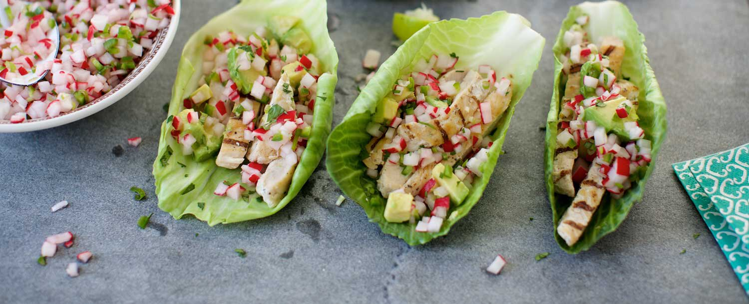 Grilled chicken tacos in pickled cabbage tortillas