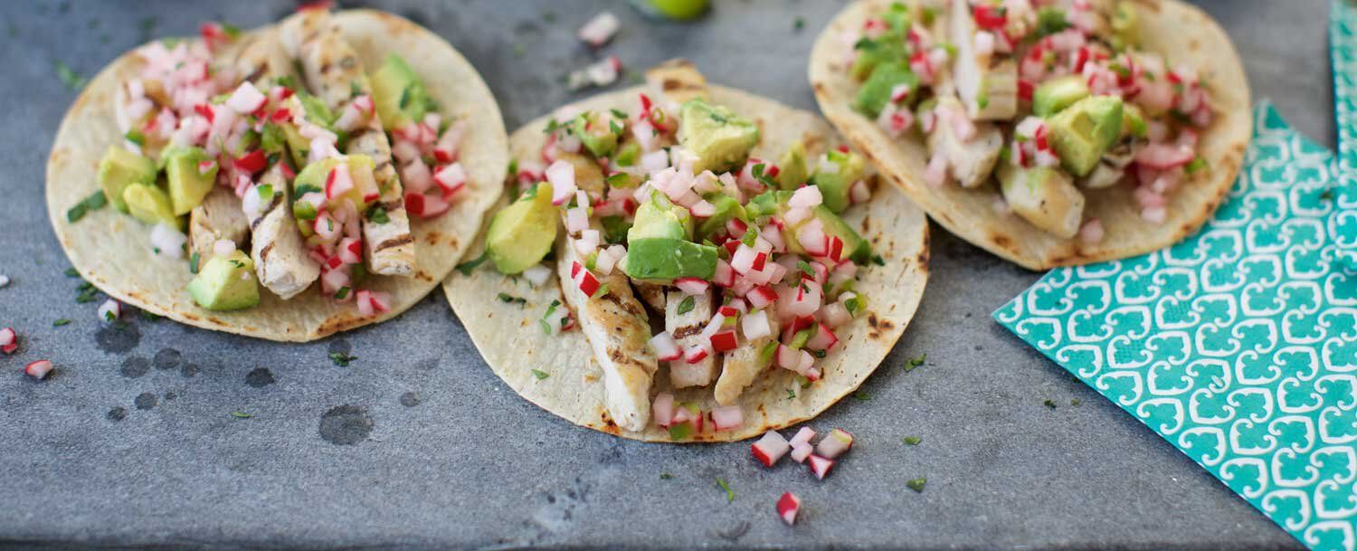 Grilled chicken tacos with radish salsa and avocado